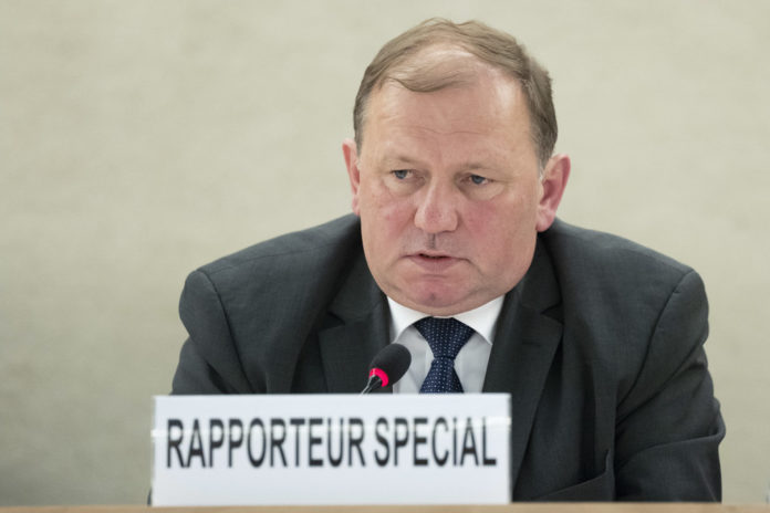 Dainius Pūras, Special Rapporteur on the right of everyone to the enjoyment of the highest attainable standard of physical and mental health present his report after his missions to Armenia and Indonesia at the 38th Regular Session of the Human Rights Council. 18 June 2018. UN Photo / Jean-Marc Ferré
