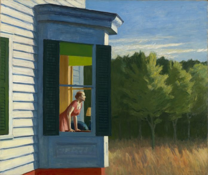 Painting by Edward Hopper showing a woman in a red dress leaning forward to look out of a large bay window of a house, towards a field of yellow grass with a grove of trees in the background and blue sky with a few white clouds overhead. The woman is small against the house and the landscape.