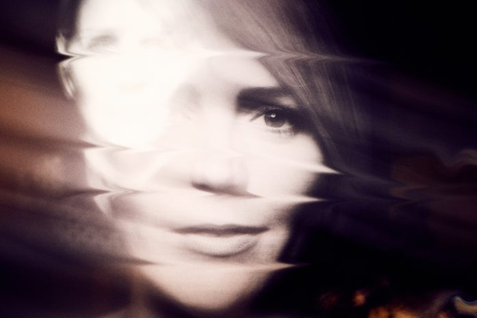 Monochrome photographic portrait of a woman distorted and blurred in horizontal streaks